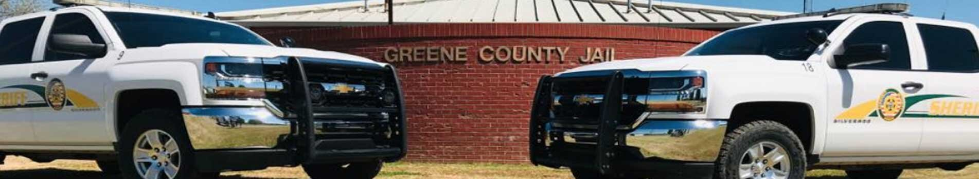 Greene County Police trucks in front of the Greene County Jail.